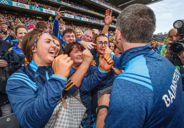 Liam Sheedy celebrates with his wife Margaret and daughters Gemma and Aislinn