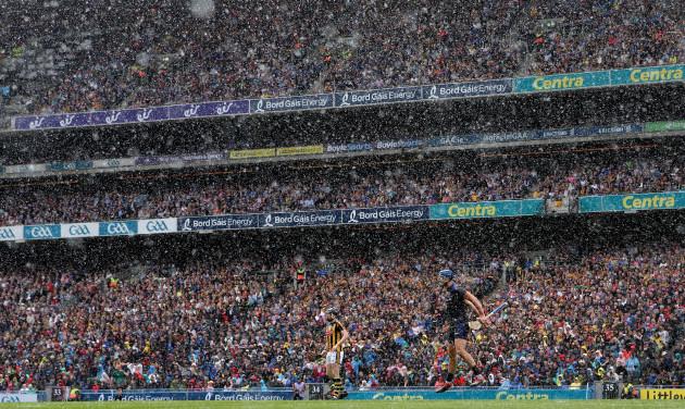Brian Hogan encourages his team during a heavy rain shower