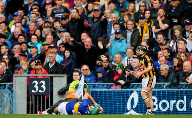Cathal Barrett lies injured following a incident with Richie Hogan