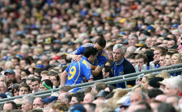 Benny Dunne is met by non playing captain Willie Ryan after being sent off