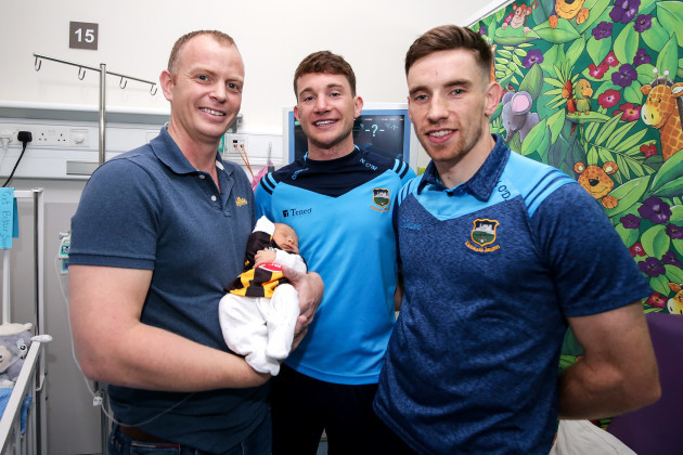 James Tracey and 5 day old Shay Tracey with Niall O'Meara and John O'Dwyer