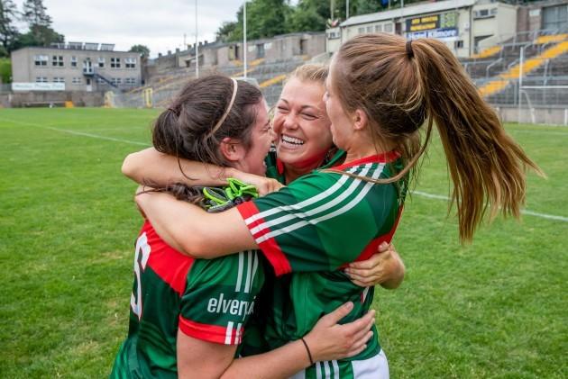 Sarah Rowe celebrates with Rachel Kearns and Sarah Mulvihill