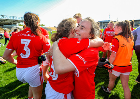 Libbby Coppinger and Melissa Duggan celebrate after the game