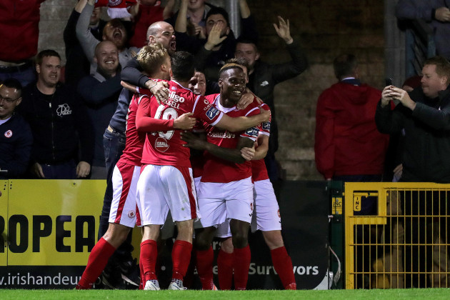 romeo-parkes-celebrates-scoring-his-sides-third-goal-with-teammates-and-a-supporter