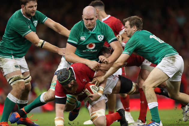 Rugby wales-jake-ball-is-tackled-by-irelands-iain-henderson-devin-toner-and-jack-carty
