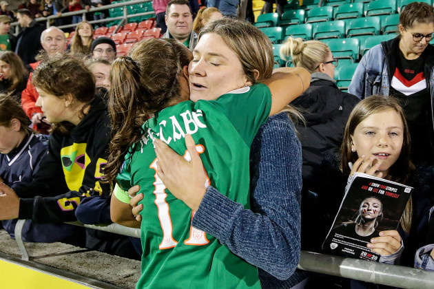 louise-quinn-celebrates-with-a-fan-after-the-game