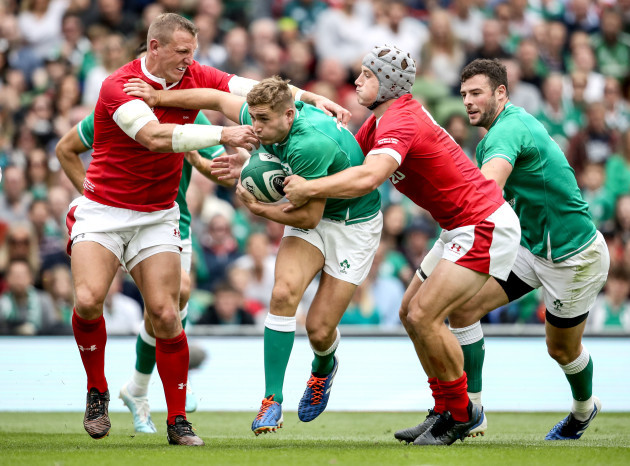 jordan-larmour-tackled-by-hadleigh-parkes-and-jonathan-davies