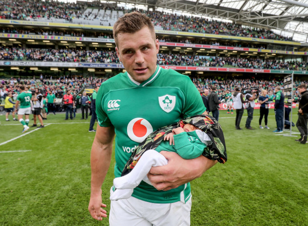 cj-stander-with-his-daughter-everli-after-the-game