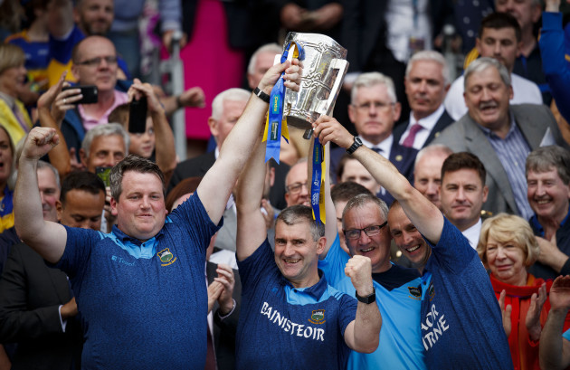 liam-sheedy-lifts-the-trophy-with-members-of-the-backroom-staff