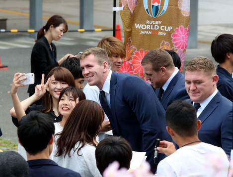 chris-farrell-akes-a-picture-with-fans-before-the-opening-ceremony