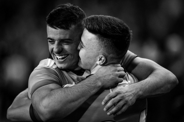 brian-howard-celebrates-after-the-game-with-eoin-murchan