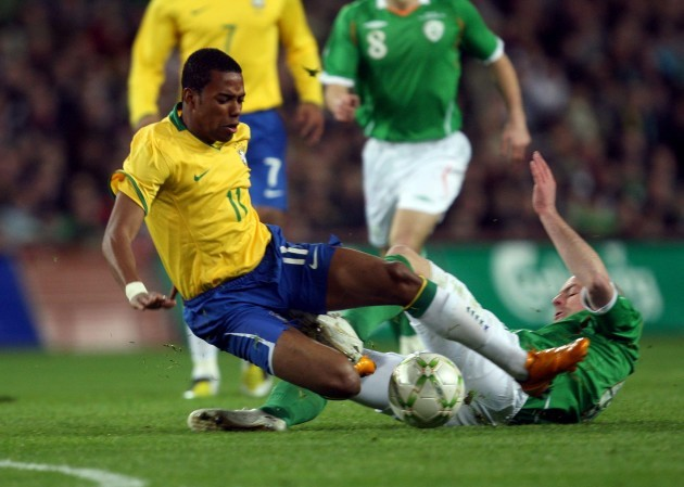 robinho-of-brazil-tackled-by-lee-carsley-of-ireland