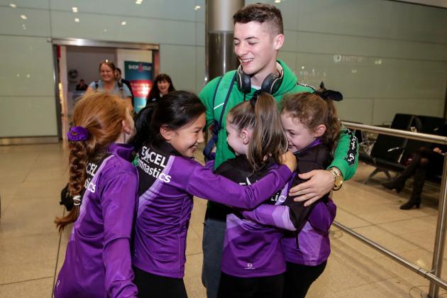 rhys-mcclenaghan-is-greeted-by-members-of-excel-gymnastics