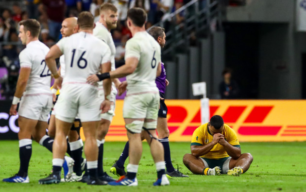 taniela-tupou-dejected-as-england-players-celebrate-after-the-game