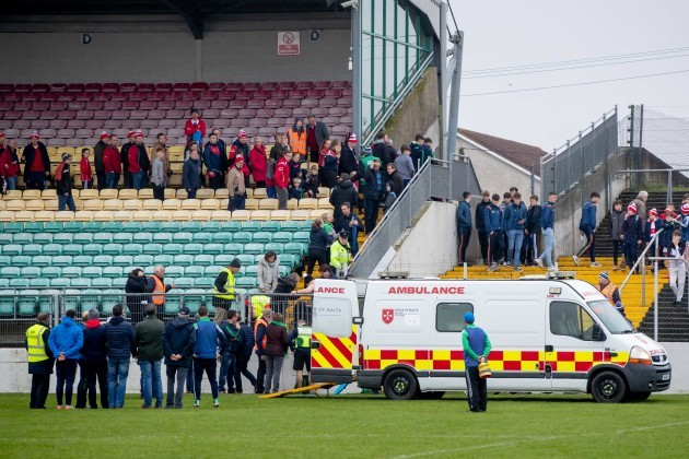 an-ambulance-on-the-pitch-at-the-full-time-whistle-treats-a-member-of-the-st-mullins-backroom-team
