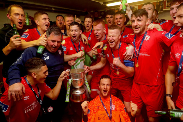 shels-celebrate-in-the-dressing-room-with-the-trophy-after-wining-the-league