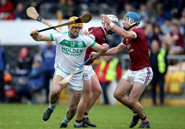 colin-fennelly-is-tackled-by-aaron-maddock-and-conor-firman