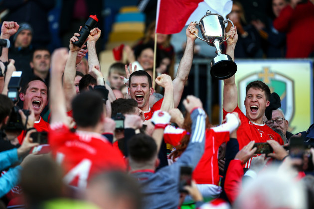 niall-carty-and-ronan-daly-lift-the-championship-cup