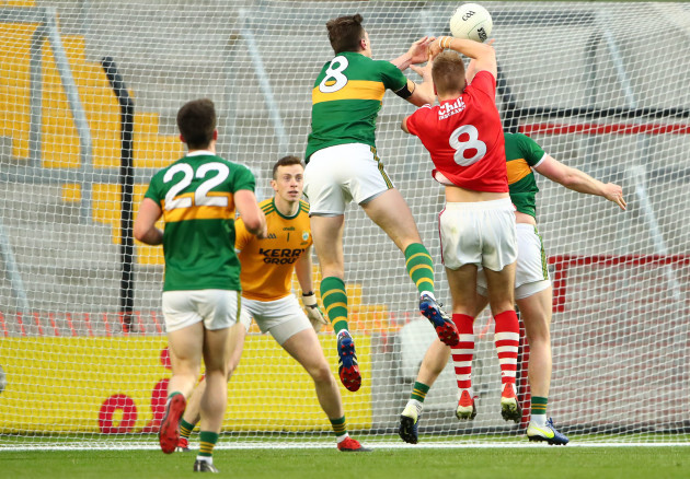 ian-maguire-competes-for-a-late-ball-into-the-box