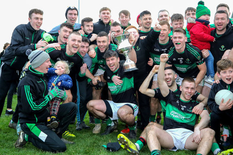 nemo-rangers-players-and-supporters-celebrate-after-the-game-with-the-munster-senior-football-cup