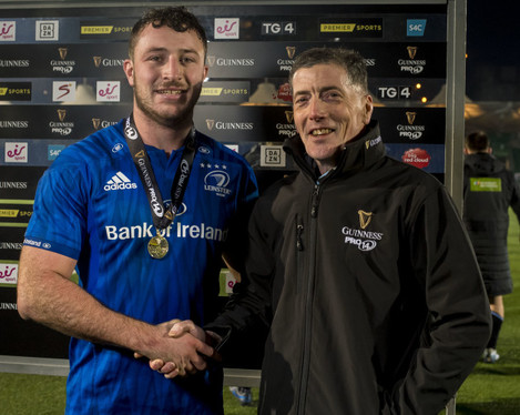 will-connors-is-presented-with-the-man-of-the-match-award-by-eric-graham