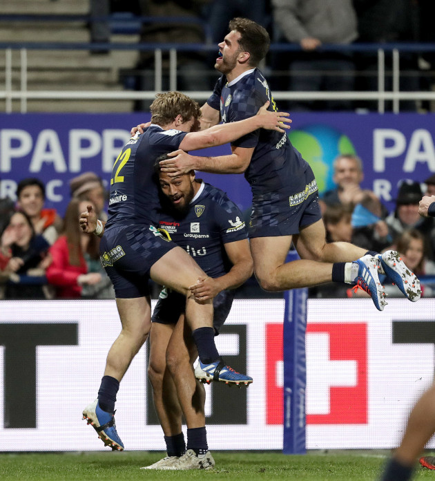 jake-mcintyre-celebrates-scoring-a-try-with-george-moala-an-damian-penaud