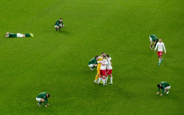 danish-players-celebrate-the-final-whistle-as-republic-of-ireland-players-fall-to-the-ground-around-them
