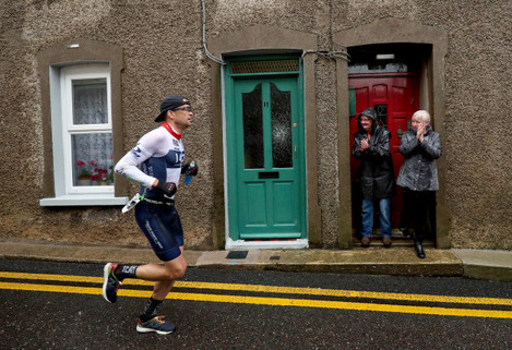 dougin-walker-is-cheered-on-by-spectators-down-the-youghal-back-street