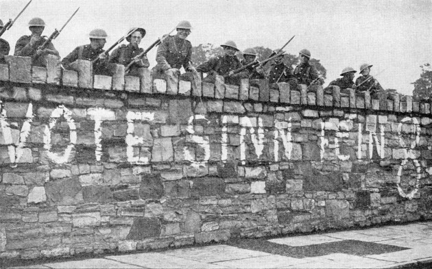 british-troops-guarding-a-wall-which-is-plastered-with-a-sinn-fein-advertisement-during-the-irish-war-of-independence-aka-anglo-irish-war-in-1920-from-twenty-five-yearspublished-1935