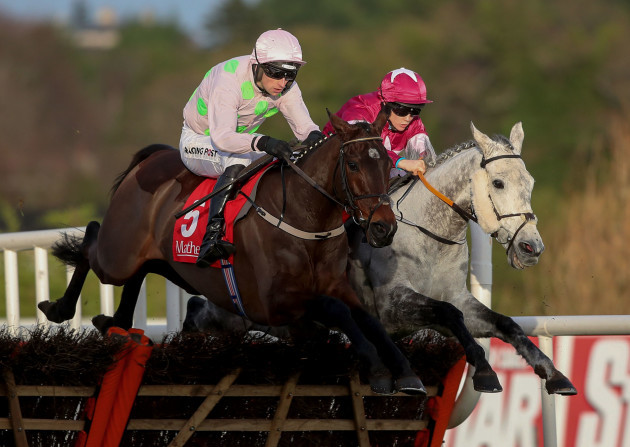 sharjah-ridden-by-patrick-mullins-and-and-petit-mouchoir-ridden-by-rachel-blackmore-jump-the-last-fence