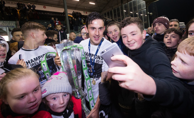 jamie-mcgrath-celebrates-after-the-game-with-fans