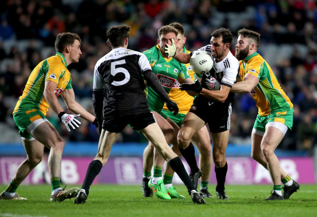aidan-branagan-is-tackled-by-conor-cunningham