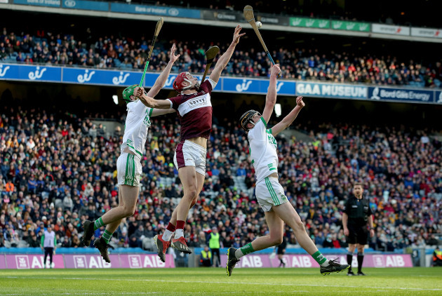 niall-kenny-is-challenged-in-the-air-by-darragh-corcoran-and-joey-holden