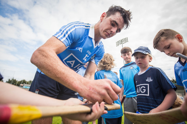 danny-sutcliffe-signs-a-young-fans-hurley-after-the-game