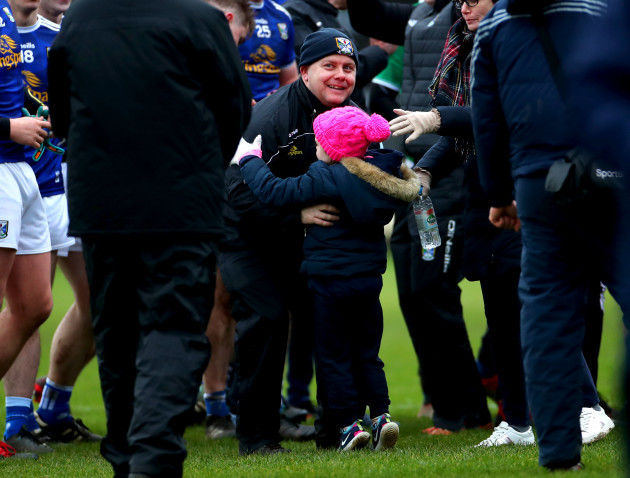 mickey-graham-celebrates-with-his-daughter-lauren-after-the-game