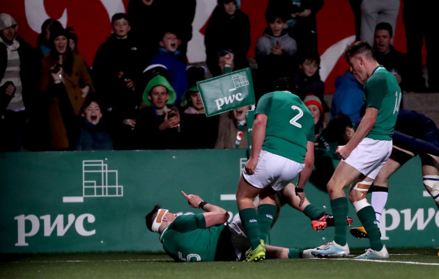 thomas-ahern-celebrates-scoring-a-try-with-tom-stewart-and-ethan-mcilroy