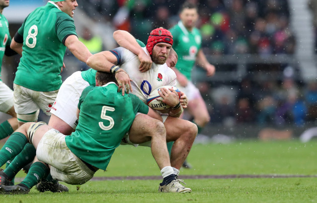 englands-james-haskell-is-tackled-by-irelands-iain-henderson-and-jack-mcgrath