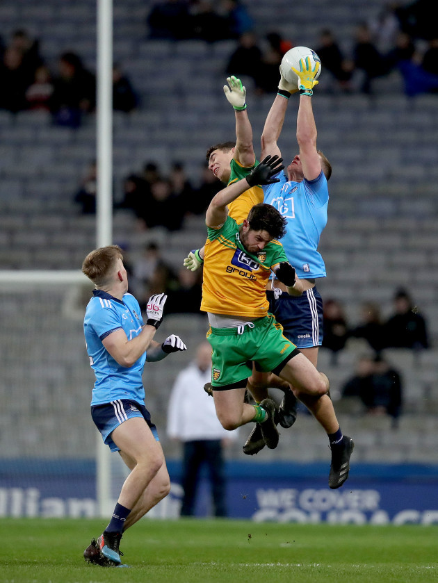 ciaran-kilkenny-wins-a-high-ball-against-ryan-mchugh-and-odhran-mcfadden-ferry