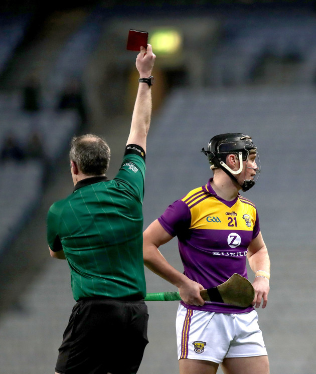johnny-murphy-shows-conor-mcdonald-a-red-card