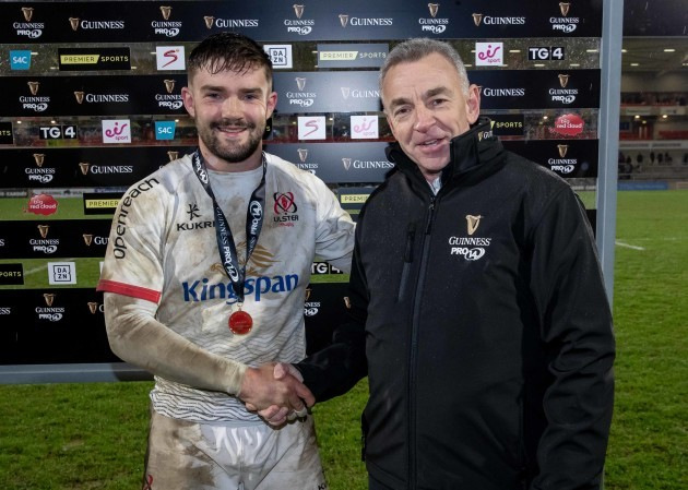 bill-johnston-is-presented-with-his-guinness-man-of-the-match-award-by-dave-callaghan