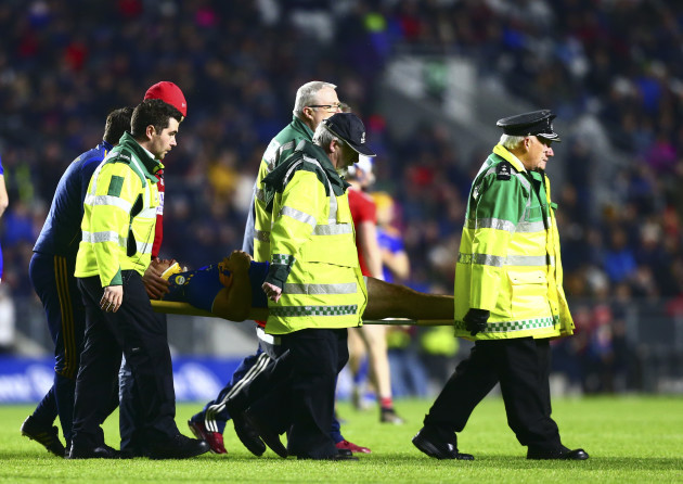 john-oaedwyer-is-taken-from-the-pitch-by-medical-staff