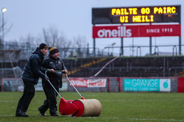 staff-at-healy-park-attempt-to-prepare-the-pitch-ahead-of-the-game