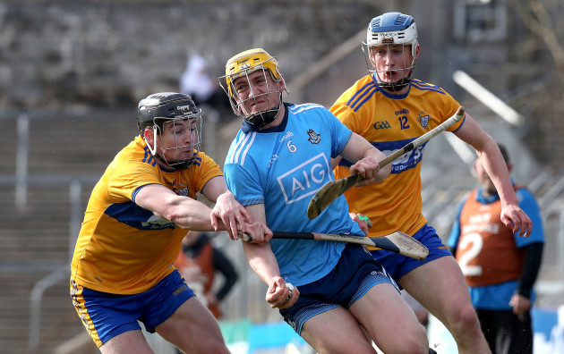 daire-gray-is-tackled-by-tony-kelly-and-diarmuid-ryan