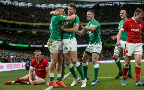andrew-conway-celebrates-scoring-a-try-with-ross-byrne-and-john-cooney