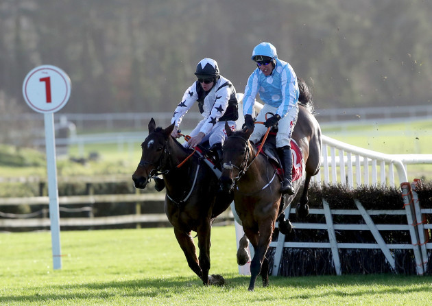 mount-ida-ridden-by-davy-russell-challenges-minella-melody-ridden-by-robbie-power-over-the-last-fence