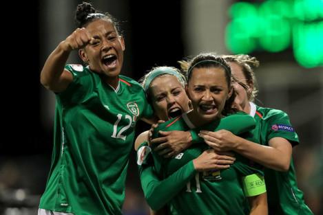 katie-mccabe-celebrates-scoring-her-sides-first-goal-with-teammates