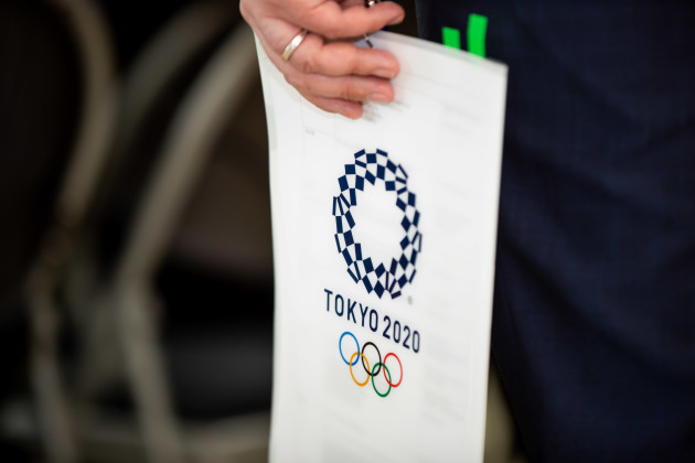 a-member-of-of-the-japanese-delegation-holds-a-tokyo-2020-document