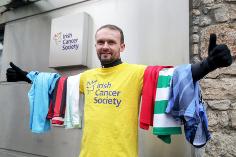 conan-byrne-pictured-with-the-jerseys-of-the-various-stadiums-he-vistied