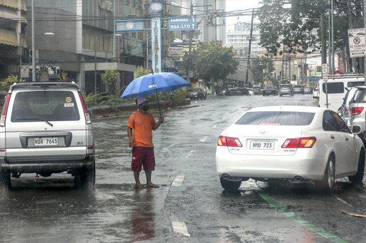 philippines-manila-typhoon-vongfong-rain