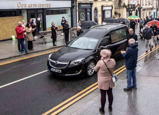 members-of-the-public-adhere-to-social-distancing-as-the-hearse-carrying-paddy-fenning-passes-by